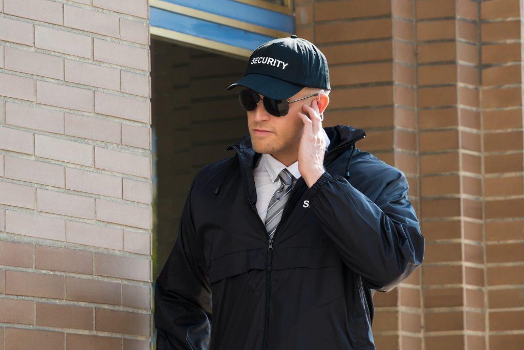 A professional short term security guard outside a building