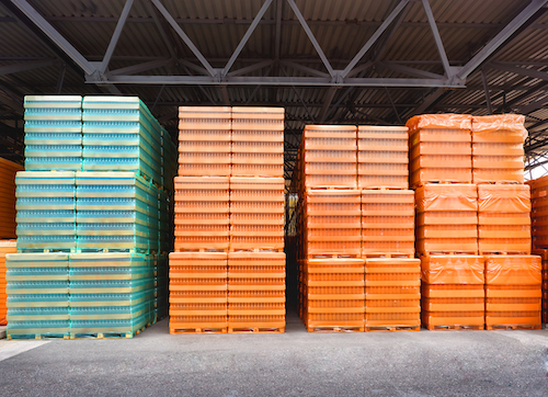 orange and blue crates at a warehouse